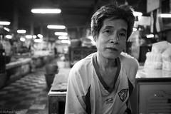 Butcher on the Night Shift, Phra Khanong (Rich Friend) Tags: fuji fujix100s portrait market butcher face mono bangkok asia thailand phrakhanong street documentary reportage travel eyes
