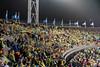 Spectators 1 (genf) Tags: toeschouwers spectators rain regen schaatsen skating allround championship world wereldkampioenschap olympic olympisch statium station amsterdam yellow regenjas flags vlaggen avond evening sony a99ii outdoor buiten