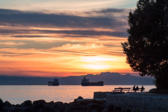 Stanley's Sunset 🌅🌳 Vancouver, BC (Michael Thornquist) Tags: sunset stanleypark seawall englishbay salishsea straitofgeorgia nanaimo vancouverisland mountainranges containership cargoship vancouverphotos vancouver britishcolumbia dailyhivevan vancitybuzz vancouverisawesome veryvancouver 604now photos604 explorecanada ilovebc vancouverbc vancouvercanada vancity pacificnorthwest pnw metrovancouver gvrd canada 500px