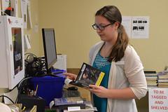 DSC_0605 (Omaha Public Library) Tags: staff omahapubliclibrary omahapubliclibrarystaff saddlebrookbranch saddlebrook books checkingin aid libraryaid