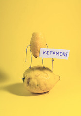 Vitamin C in fruits and vegetables. Natural products rich in vitamin C as oranges, lemons, lemon with arms and legs lying on a orange , lemon sunbathing getting vitamins (franviser) Tags: abstract background beautiful beauty c care citrus closeup color concept cosmetic cosmetics diet drink eating exotic face food fresh freshness fruit fruits glass health healthy ingredient isolated juice juicy lemon lemons lifestyle medical natural nature orange organic pattern pharmacy product raw red ripe skin slice sweet table top tropical vegetarian view vitamin vitamins white yellow