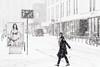 (Zesk MF) Tags: snow woman walking street candid mono bw black white zesk winter business rush