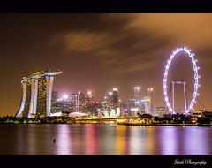 Singapore Skyline (Jikesh k) Tags: singapore skyline night long exposure flyer marina bay sands raffles canon 60d