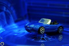 s h o w r o o m (NadzNidzPhotography) Tags: nadznidzphotography 7dwf crazytuesdaytheme ctt prettyinblue blue car diecast toy toycar display creative monochrome monochromatic minimalism minimalist