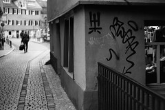 Inside and outside (Leica M6) (stefankamert) Tags: stefankamert street outside inside city tübingen people signs graffiti film analog grain dof blur leica m6 rangefinder summicron summicrondr kodak trix noir bw baw blackwhite blackandwhite