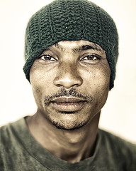Ethiopia Proud (mckenziemedia) Tags: ethiopia ethiopian strong strength men man green hat skin face portrait portraiture people