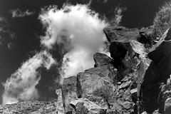 Tahquitz Canyon Rock Formation (bac1967) Tags: tahquitz canyon tahquitzcanyon palmsprings palmspringsca palmspringscalifornia california ca kodak tmx tmax kodaktmx kodaktmax kodaktmx100 black white blackandwhite blackandwhitefilm blackwhite bw monochrome monotone kodakmedalist 620 620film landscape clouds boulder rock rockformation sky cahuilla caliente aguacaliente irrigationditch beerol beerenol pabstblueribbonbeer caffenol