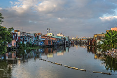 Just build on the water (Rakuli) Tags: ifttt 500px riverbank pier marina tourboat lake river pedal boat jetty moored townscape recreational water saigon houses shacks shanty reflection clouds afternoon