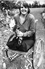 shirley in the garden (jackcast2015) Tags: amputee legamputee wheelchairwoman wheelchair disabledwoman crippledwoman amputeewoman nolegs doubleabovekneeamputee dakamputee