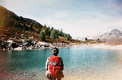 (Bazzerio) Tags: film vintage bazzerio analogue analog adventure fujifilm forrest filmisnotdead mountain mountains travel tumblr trek women switzerland zermatt lake landscape backpack dof depth blue flare trees hike wildcamp camping