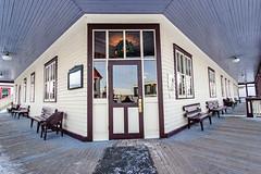 Porch of hotel (begineerphotos) Tags: heritageparkchristmas winter hotel wainwrighthotel porch reflection door window bench lines friendlychallenges 15challengeswinner