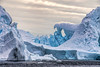 Ice arches (Travels with Kathleen) Tags: antarctica icebergalley icebergs ice water sky scenic nature blue pleneauisland