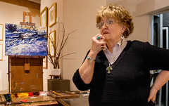 artist on duty (.sanden.) Tags: cross artist painting woman portrait gallery sagefineartgallery newmexico taos canon7dmarkii blacksweater glasses candid ef24105mm