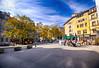 Old Town Square in Geneva, Switzerland (` Toshio ') Tags: toshio geneva geneve switzerland swiss placebourgdefour autumn fall oldtown square trees cafe restaurant europe european fujixt2 xt2 umbrella people morning sky