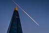 Pink vapor trail above the Shard, London (Gabyinengland) Tags: london shard blue city architecture building vapor trail cityscape sunset goldenhour