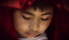 Child with Red Blanket (Christina's World-) Tags: painterly portrait people artistic red realpeople brilliant creative candid colorful candidportrait child eyes dramatic exoticimage exotic fragile boy hair face head male outdoors street streetphotography textures unitedstates usa young spanish latino