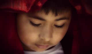 Child with Red Blanket