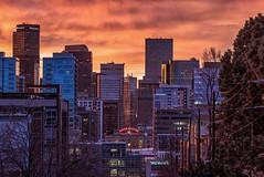 Sunrise Over Downtown Denver. (mnryno) Tags: coloradotography unionstation orange sky clouds colorful colorado denver sunrise