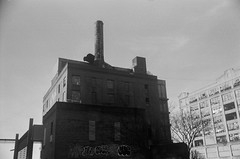 Abandoned Warehouses, Brooklyn (josephkrings) Tags: 1stavenue abandoned brooklyn greenwoodcemetery ilfordhp5 newyork nikkor28105mm13545 nikonn70 sunsetpark blackandwhite brokenglass warehouse