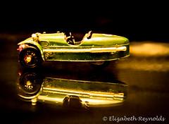 Day 68. (lizzieisdizzy) Tags: inside indoors indoor car modelcar morgan threewheeler racinggreen table tabletop exhaustpipes twoseater toy toycar parrellel reflection reflections reflective reflect
