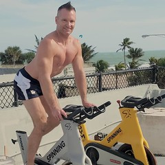 spinning (ddman_70) Tags: shirtless muscle pecs outdoor gym workout spinning shortshorts