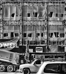 Framework (Demmer S) Tags: building street windows grid framework structure foundation shell external outdoors exterior outside repeating pattern frame lines window openings punctured cut covering construction cars trucks automobiles streetphotography shootthestreet streetshots documentary citylife urban city urbanphotography streetscene constructionsite underconstruction workers working hardhat project repairing facade restoration renovating reconstruction repairs repairwork car truck auto automobile sign architecture architectural chicago il illinois windycity downtown loop chicagoland chicagoist chicagoistphotos michiganave magnificentmile michiganavenue bw monochrome blackwhite blackandwhite blackwhitephotos blackwhitephoto