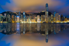 Hong Kong City skyline at sunrise. View from across Victoria Harbor Hongkong. (MongkolChuewong) Tags: aerial architecture asia asian background beautiful blue building buildings business china city cityscape day district downtown evening harbor harbour hong hongkong kong landmark landscape light metropolis modern mountain night office panorama panoramic peak peaks reflection scene scenic sea sky skyline skyscraper sunrise sunset tourism travel traveler urban victoria view