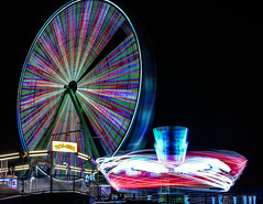 ...meanwhile over by the tilt a whirl (pbo31) Tags: oakland california eastbay alamedacounty nikon d810 color night black dark ride fair lightstream motion carnival traveling spinning midway boury pbo31 march 2018 butleramuesments