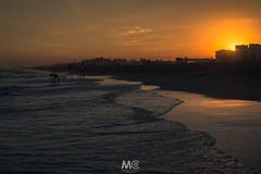 Don't turn off the light (Mariano Colombotto) Tags: pinamar argentina beach playa sunset atardecer sea mar summer verano light silhouttes backlight sky cielo contraluz nikon ngc travel photographer photography