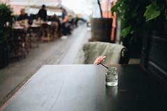 Lonely flower [E] (borishots) Tags: flowers flower flora flowerpot lonelyflower woodentable bokeh bokehlicious bokehwhore sony sonya7 sonyalpha sonyalpha7 sonyalphailce7 sonyfe28mmf2 28mm 28mmf2 f2 wideopen wideangle analog retro vintage copenhagen denmark scandinavia travel travelphotography detail details pink mood water glass