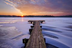 Winter Jetty Sunrise II (Matt Rimkus Photography) Tags: schleswigholstein flare sunrise sunburst bossee frost snow jetty lake ice clouds westensee deutschland de