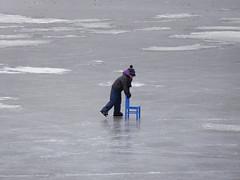 Perseverance (EvelienNL) Tags: winter ice skating skater skaters frozen water lake outdoor cold ijs schaatsen schaatser schaatsers bevroren meer randmeer natuurijs koud nuldernauw nijkerk putten dutch holland netherlands people sport sports kid child chair kind stoel