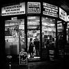 IMG_5769 (Kathi Huidobro) Tags: london urbanphotography streetphotography urbanscene urban candid shopping shopfront blackwhite bw monochrome londonshops afterdark nightlife cornershop