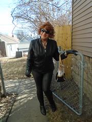 Lurking (Laurette Victoria) Tags: jacket gloves pleather leggings boots sunglasses purse redhead curly laurette woman