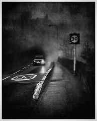Long Wall (mono) (Father Pie) Tags: edge50 elland lensbaby blur street headlight car mist fog mono blackwhite