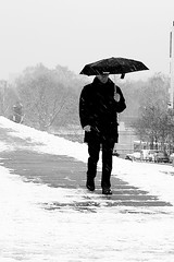 On the snowy passage (pascalcolin1) Tags: paris13 homme man parapluie umbrella neige snow passage chemin path photoderue streetview urbanarte noiretblanc blackandwhite photopascalcolin 50mm canon50mm canon