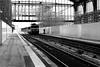 In front of the locomotive (pascalcolin1) Tags: paris13 austerlitz gare station locomotive femme woman photoderue streetview urbanarte noiretblanc blackandwhite photopascalcolin 50mm canon50mm canon