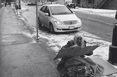 "A ""Have"" and a ""Have not"": Bay Street, Hamilton (Xsbmrnr (Please read profile before ""following"") Tags: blackandwhite bandw street streetphotography streetportrait streetpeople film filmphotography 35mm 35mmfilm hamilton hamiltonontario hc110 olympusom1 olympus om1"