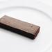 Healthy chocolate bar dessert on white background.