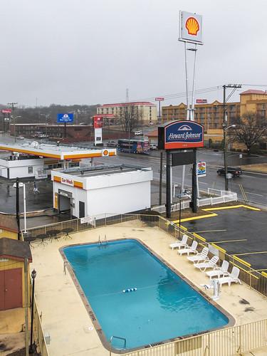 Blue jewel of gas station car wash swimming pool.