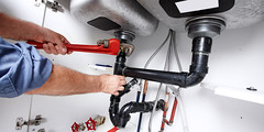 Hands of professional Plumber with a wrench. Clogged sink. (Best Brothers Group) Tags: adjustable background bathroom builder carpenter clog commercial construction contractor diy drain entrepreneur foreman hands handyman home house industrial industry job kitchen labor male man manual object people person pipe plumber plumbing professional renewal renovation repair repairman residential service sink staff tools valve worker working workman wrench