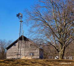 Crossroads_186891 (rjmonner) Tags: windmill windmillwednesday iowa rural barn weathered tree winter dormant country aged