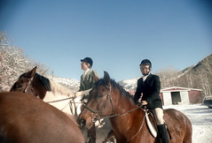 1a-215 (ndpa / s. lundeen, archivist) Tags: nick dewolf nickdewolf photographbynickdewolf 1977 1970s color 35mm film 1a reel1a aspen colorado fall autumn snow november rockymountains foxhunt hunt woodycreek woodycreekhounds roaringforkvalley equestrian equestrians horse horses horseback rider riders hat hats jodhpurs woman women boots glasses eyeglasses ranch building barn chinstrap roaringforkhunt roaringforkhounds