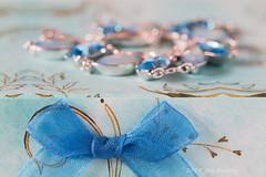 Blue Bracelet on a Blue Box with Blue Bow (Jamarem) Tags: macromondays blue stilllife tabletop bow ribbon jewellery bracelet silver canoneos70d 100mm box bokeh