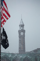 Snow falls on the Hoboken Terminal Clock Tower as a nor'easter rolls through Hoboken on March 21, 2018. (apardavila) Tags: americanflag erielackawannaterminalclocktower hoboken hobokenterminalclocktower flag noreaster noreasterstorm snow snowstorm storm weather