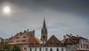 The town of Sibiu, Transylvania, Romania (Peraion) Tags: sun town sibiu transylvania europe chirch spire houses sky clouds mist