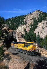 Green and yellow on the Moffat (Moffat Road) Tags: chicagonorthwestern cnw ge ac4400cw 8802 moffat unionpacific up formerriogrande tunnel cliffs rock curve upmoffattunnelsub tunnel29 cliff pinecliffe colorado coaltrain locomotive train railroad co