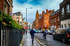 Around London, United Kingdom (` Toshio ') Tags: toshio london england unitedkingdom rain people walking street city greatbritain europe european europeanunion car traffic man gate clouds fujixt2 xt2