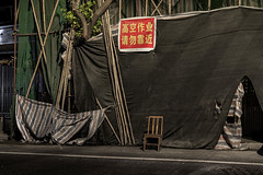 Coming soon: China. Everything happens at the same time. (Markus Lehr) Tags: street buildingsite bamboo chair cloth tree nopeople peoplelessness urbanspace humanartifacts guangzhou china