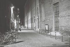 Rimini (goodfella2459) Tags: nikon f4 af nikkor 50mm f14d lens kodak tmax 400 35mm blackandwhite film analog night rimini italy city streets buildings bikes road door lights bwfp